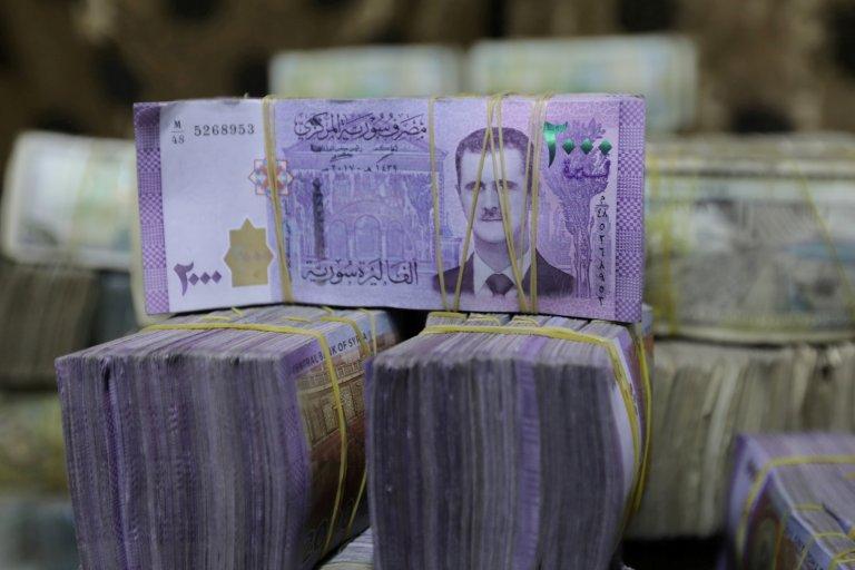 """حكومة الأسد تقترح حذف صفر من العملة السورية وحاكم المصرف يعلق """"ثقوب سوداء"""" 9"""