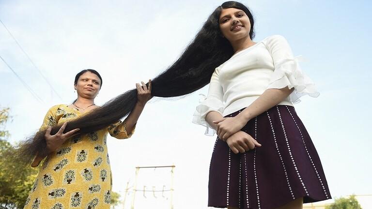 صاحبة أطول شعر بالعالم تقصه وتتبرع به لمتحف أمريكي 16