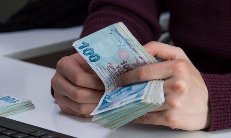 جمعية تركية توزع بطاقات ماركت بقيمة 300 ليرة تركية للمئات من العائلات السورية 1